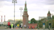 Unrecognizable blurred marathon runners and cyclists against Moscow Kremlin. 4K Stock Footage