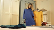 Girl bedroom clothes trying annoyed Stock Footage