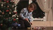 Kid near Christmas tree. Stock Footage