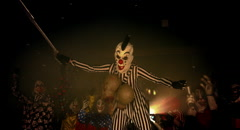 Horror clowns. The clown on stilts holding a chain with decapitated. Stock Footage