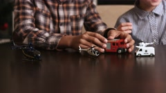 Boys playing with toy cars. Stock Footage