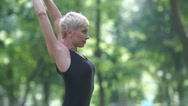 A woman stands on the mat in the park. Stock Footage