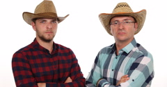 White Background Indoor Scene Farmer Men Looking Camera and Posing Serious Look Stock Footage