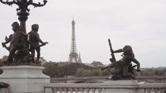 Classical statues on bridge Alexandre III and  eiffel tower in the background Stock Footage