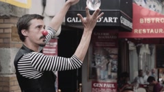 Street artist / performer with a crystal  abll  in Paris Stock Footage