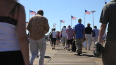 FLUSHING, NEW YORK - SEPT 1, 2012: US Open Tennis fans walk past American flags Stock Footage