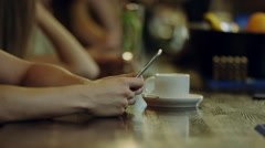 Man typing on a phone at a bar counter Stock Footage