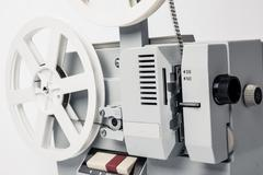 Old film projector isolated on a white background Stock Photos