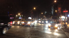New York city traffic and pedestrians move down an Stock Footage