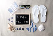 Sunny Blackboard On Sand With Text Happy New Year Stock Photos