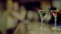 Two martini glasses on a bar counter Stock Footage