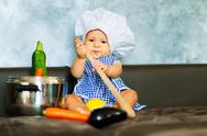 Little boy playing at being a chef Stock Photos