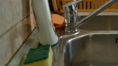 Young Woman Preparing To Wash Dishes, Taking The Sponge And Pouring Detergent Stock Footage