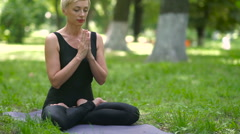 Instructor distracted during meditation. Stock Footage