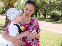 Happy mother with cute baby boy having tropical vacation on Maldives. Kid Stock Photos