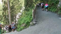 Hiking along path of krimml waterfalls Stock Footage