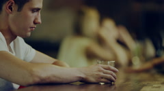 Man drinks alcohol and looks at women Stock Footage