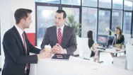 4K 2 Businessmen in discussion in modern city office Stock Footage