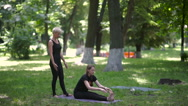 The instructor helps to tilt the girl's feet. Stock Footage