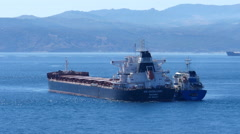 Cargo ship being supplied in Gibraltar bay Stock Footage