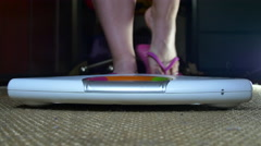 Young Woman Getting Off Her Slippers To Get On A Scale, Weight Check, Detail Stock Footage