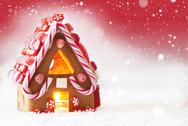 Gingerbread House, Red Background With Snowflakes, Copy Space Stock Photos