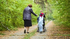 Grandmother with grandchildren walking in the Park Stock Footage