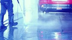 Man worker washing car in slowmotion. 1920x1080 Stock Footage