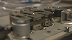 Close up of tape rolling in Nagra old tape recorder Stock Footage
