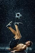 Water drops around football player under water Stock Photos