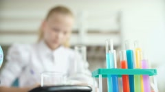 Test tubes with colored chemical reagents. Chemical flasks Stock Footage