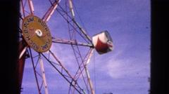 1963: people enjoying on ferris wheel in a theme park DEVILS LAKE, WISCONSIN Stock Footage