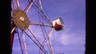 1963: people enjoying on ferris wheel in a theme park DEVILS LAKE, WISCONSIN Stock Footage