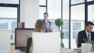 4K Business man & woman having conversation in modern city office Stock Footage