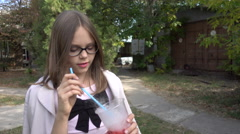 Girl with glasses in the park drinking a Cocktail Colourful Smoky Stock Footage
