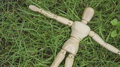 Wooden human figure lay down on grass garden relax Stock Photos
