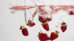 Strawberries Falling into Water 004 Stock Footage
