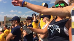 College Fans React to Play at Football Game Arkistovideo