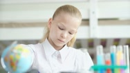 Serious teen girl doing homework. 11-13 years old girl Stock Footage