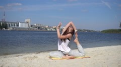 Girl showing Yoga Exercises on the background of Nature near the River Stock Footage