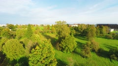 Cityscape with Public Garden at autumn sunny day. Aerial footage. Stock Footage