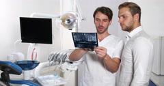 Medical Doctor Dentist Man Examine Radiography Control Explaining Dental Clinic Stock Footage
