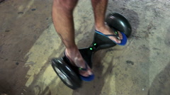 Man using hover board, a self-balancing two-wheeled board Stock Footage
