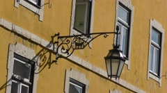 Building with street light fixture, Lamp hanging on the wall Stock Footage