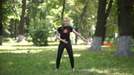 The girl doing exercises in the park. Stock Footage