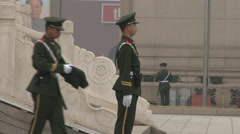 Two young soldiers stand guard at the base of Monument to the People, 4K. Stock Footage