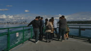 Group tourists take photos as ferry departs Seattle Stock Footage