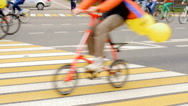 Many people are riding bicycles on city streets Stock Footage
