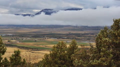Time lapse-Low cloud layer moving over rural mountain valley Stock Footage