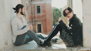 Overcome the crisis in the relationship. Young man and woman hold hands. Sit on Stock Footage